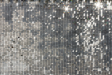 Silver background mosaic with light spots and stars