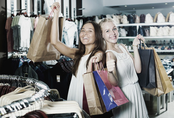 Girls holding shopping paper bags