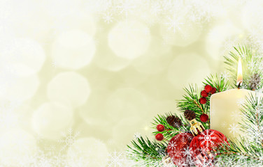 Background with pine twigs, candle and Christmas decorations