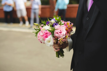 Groom with Flowers in Street