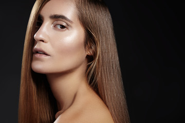 Wall Mural - Well being, wellness & spa. Sensual woman model with shiny straight long dark hair and fashion make-up. Health, beauty, hair-care, cosmetics and make-up. Beautiful fashion smooth shiny hairstyle