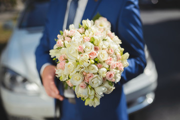 Groom in Blue Suit with Bouquet