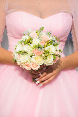 Bride with Roses in Hands