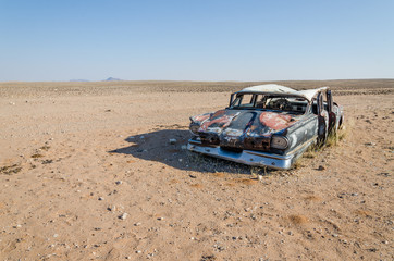 Wreck of classic saloon car abandoned deep in the Namib Desert of Angola
