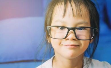 portrait of Asian Nerdy girl is wearing glasses.