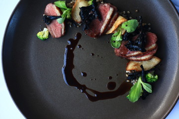 Duck breast with broccoli, buckwheat and black trumpet mushroom