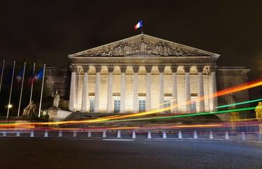 Night view of the French parliament Assemblee Nationale (Palais Bourbon) in Paris