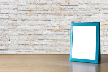 Empty blue brochure put on wooden table isolated on white