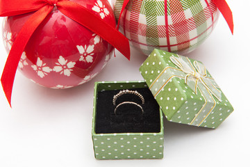 ring in christmas gift box and tree decoration on white backgrounds