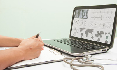Doctor writing a medical prescription.