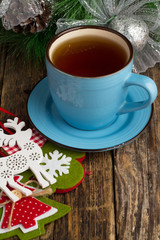wood background and a cup of tea, Christmas decorations