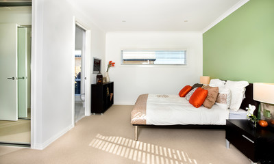 Classic bedroom of a modern house with white Bed and a lot of pi