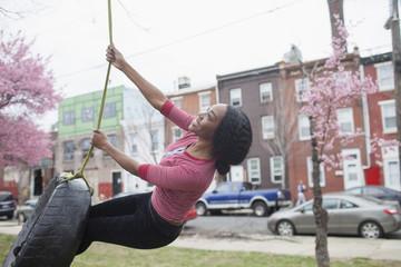 Woman on tire swing.