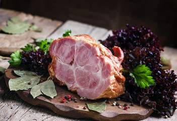 Smoked pork, old wooden background, selective focus