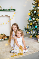 Girl near the fireplace at Christmas with gifts in their hands, the New Year