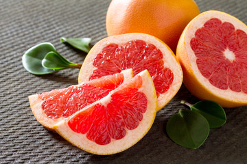 Red Grapefruit on a concrete gray background. The concept of hea
