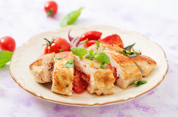 Grilled Chicken breast stuffed with tomatoes, garlic and basil