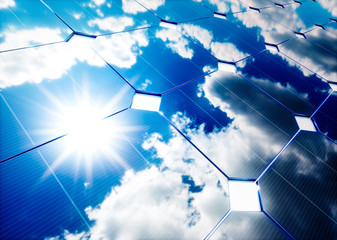 Solar energy concept. Blue sky reflection on photovoltaic panel.