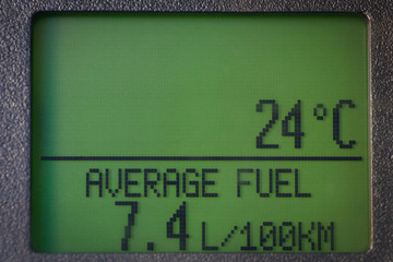 Car display with average fuel consumption and temperature