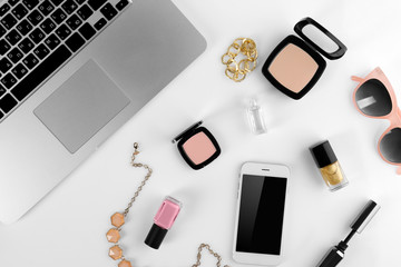 Workplace with laptop and women accessories, top view