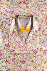 Folded floral shirts on floral pattern