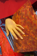 Hand with orange and red background, artwork