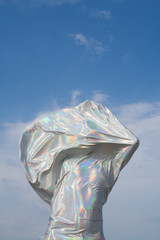 Person draped in silver fabric