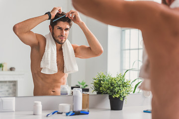 Sexy guy caring of his appearance