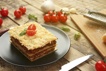 Homemade meat lasagna on wooden table