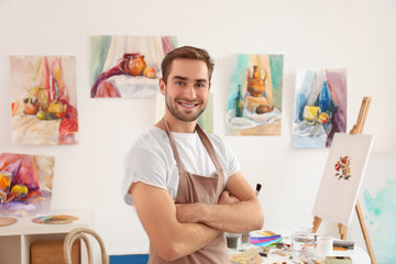 Young male artist in studio