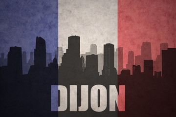 abstract silhouette of the city with text Dijon at the vintage french flag