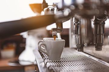 espresso machine pouring beverage into the mug
