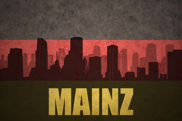 abstract silhouette of the city with text Mainz at the vintage german flag