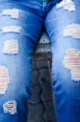 Jeans background texture,Denim jeans texture or denim jeans background with old torn. Old grunge vintage denim jeans. Stitched texture denim jeans background of fashion jeans design. Dark edged.
