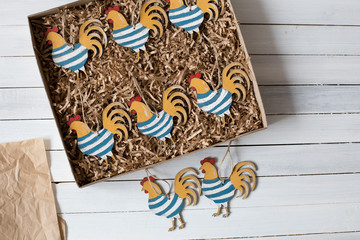 Christmas decorations on rustic wooden background. Christmas  cocks