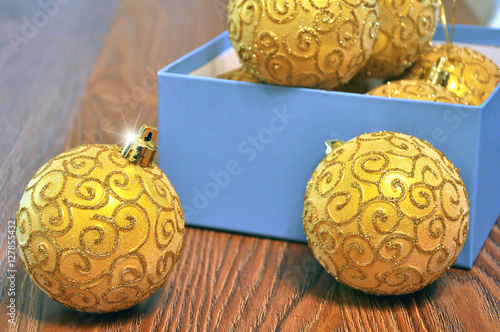 Brilliant Gold Christmas Tree Decorations In A Box On A Floor Stock Extraordinary Christmas Tree Decorations In A Box
