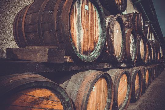 wooden barrels in the distillery folded in the yard in shelves