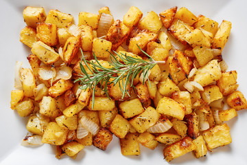 Baked potatoes on square white dish