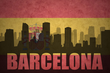 abstract silhouette of the city with text Barcelona at the vintage spanish flag