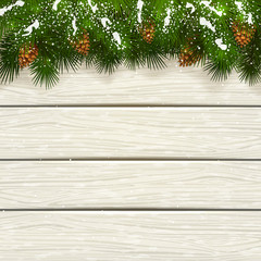 Christmas white wooden background with snow on fir tree branches