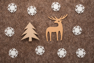 Christmas composition with a deer, tree and snowflakes