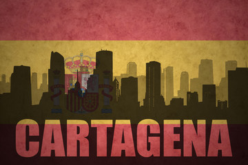 abstract silhouette of the city with text Cartagena at the vintage spanish flag