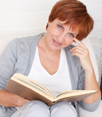 Adult woman reading book