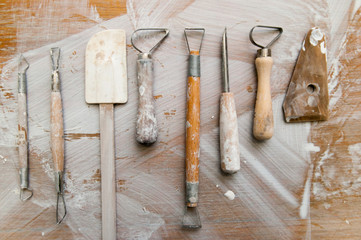 Work tools in a messy ceramics workshop