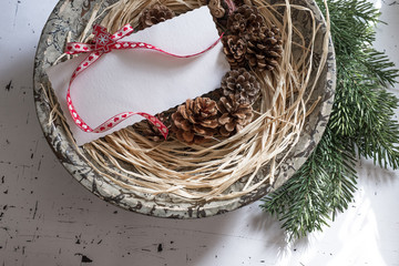 Empty greeting card with pine cones decoration