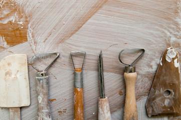 Work tools in a messy ceramics workshop