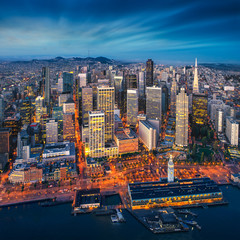 Wall Mural - San Francisco aerial view from sea side. Port of San Francisco in the front. City downtown and skyscrapers at sunrise.