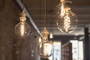 Vintage style round light bulbs hanging from the ceiling