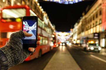 Taking photo of Christmas London on mobile phone