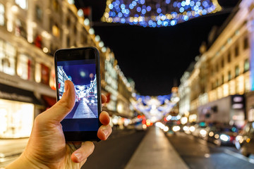 Taking photo of Christmas London on mobile phone